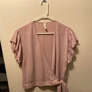 Pink cross top with ruffle